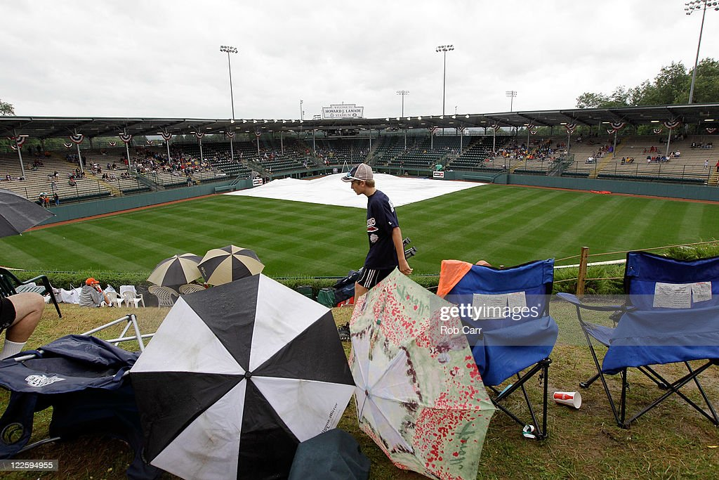 Fans set up chairs in center field during a rain delay before the start of the Little League World Series championship game between the Japan team from Hamamatsu City, Japan and the West team from Huntington Beach, California on August 28, 2011 in South Willamsport, Pennsylvania.