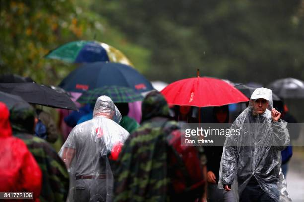 Fans shelter from the rain during final practice for the Formula One Grand Prix of Italy at Autodromo di Monza on September 2 2017 in Monza Italy