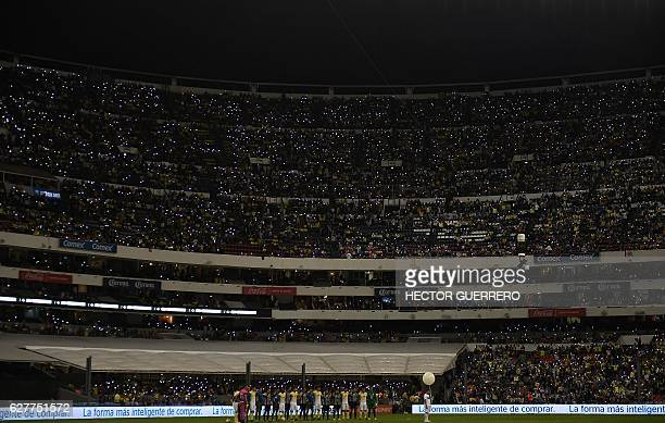 TOPSHOT Fans shine lights during the oneminute of silence in memory of the footballers of the team Chapecoense of Brazil killed tragically in a plane...