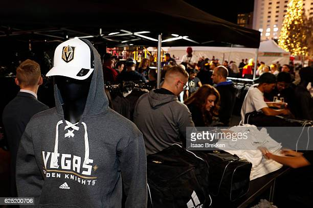 Fans shop for merchandise after the unveiling of the new logo and name for the Vegas Golden Knights in Toshiba Plaza at TMobile Arena November 22...