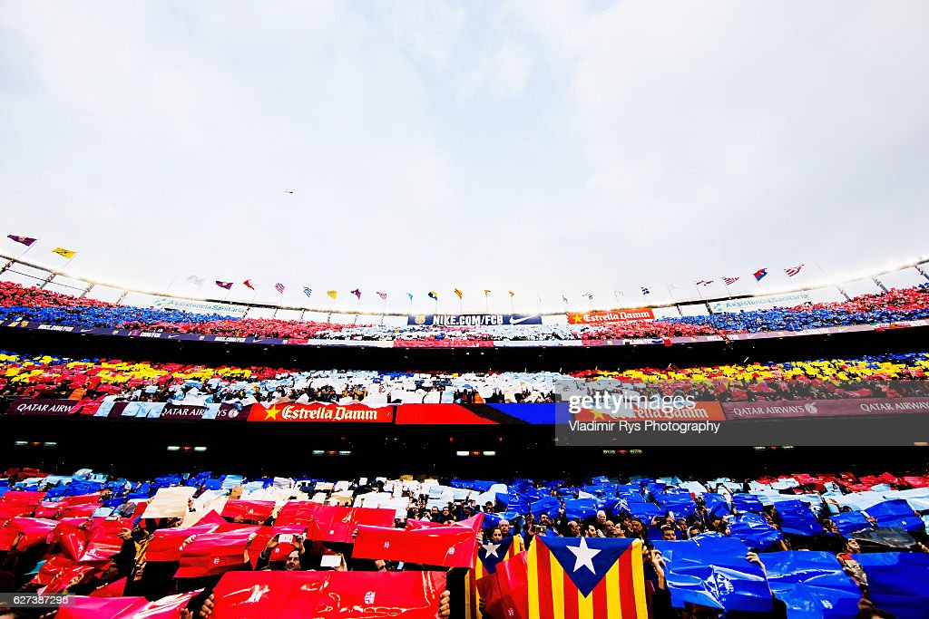 Fans show a choreography as teams enter the pitch for the La Liga match between FC Barcelona and Real Madrid CF at Camp Nou stadium on December 03...