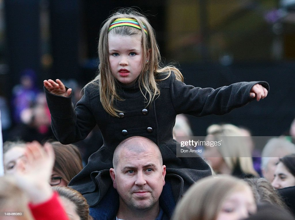 Fans show their appreciation as Justin Bieber performs live on the Sunrise program at The Overseas Passenger Terminal on July 18, 2012 in Sydney, Australia.