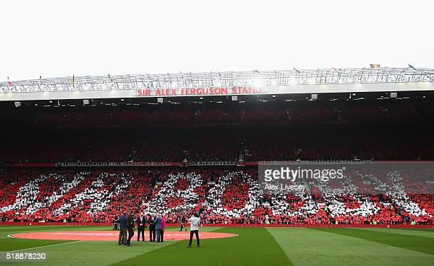 Fans show their appreciation as the South Stand is unveiled as the newly renamed Sir Bobby Charlton stand to honour 60 years since his Manchester...
