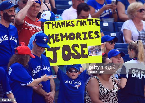 Fans show their appreciation with a sign for Jose Bautista of the Toronto Blue Jays during MLB game action against the New York Yankees at Rogers...