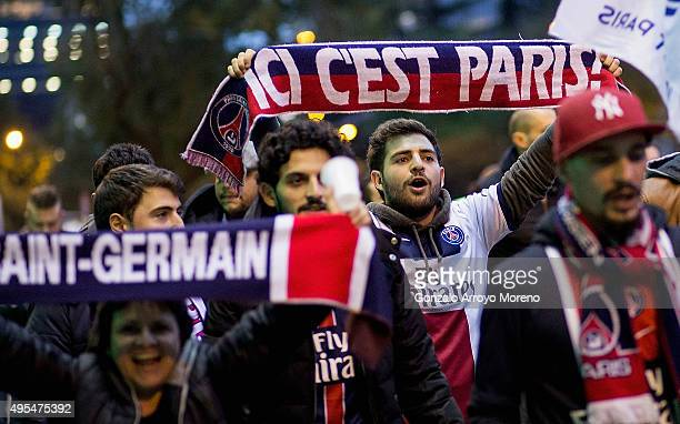 Fans show their support as they arrive prior to the UEFA Champions League Group A match between Real Madrid CF and Paris SaintGermain at Estadio...