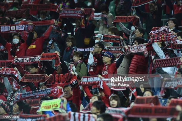 Fans show their support during the AFC Champions League Group F match between Urawa Red Diamonds and Western Sydney Wanderers at Saitama Stadium on...