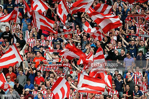 PSV fans show their support during the Eredivisie match between PSV Eindhoven and Ajax Amsterdam at Philips Stadion on April 14 2013 in Eindhoven...