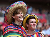 Fans show their support during the Men's Football Semi Final match between Mexico and Japan on Day 11 of the London 2012 Olympic Games at Wembley...