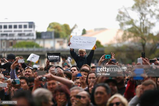 Fans show their support during the New Zealand All Blacks welcome home celebrations at Victoria Park on November 4 2015 in Auckland New Zealand