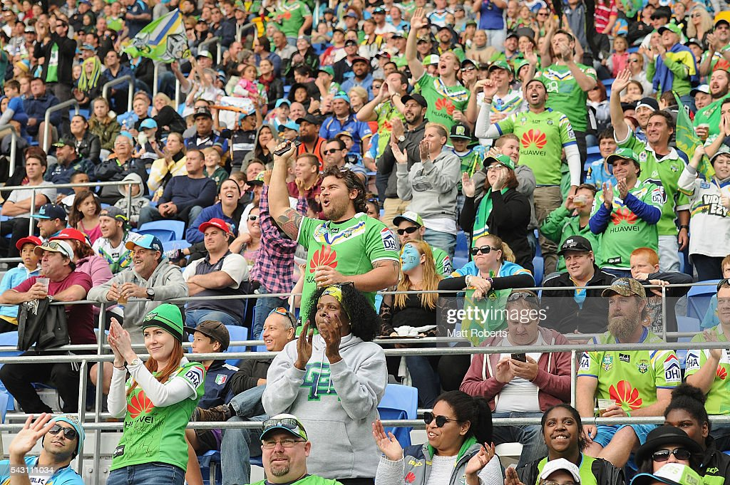 Fans show their support during the round 16 NRL match between the Gold Coast Titans and the Canberra Raiders at Cbus Super Stadium on June 26, 2016 in Gold Coast, Australia.