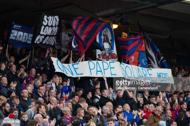 Fans show their support for Crystal Palace's Pape N'Diaye Souare during the Carabao Cup Third Round match between Crystal Palace and Huddersfield...