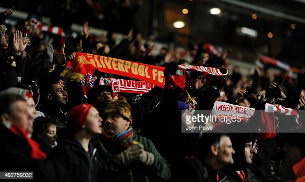 Fans show their support for Liverpool at the end of the FA Cup Fourth Round Replay match between Bolton Wanderers and Liverpool at Macron Stadium on...