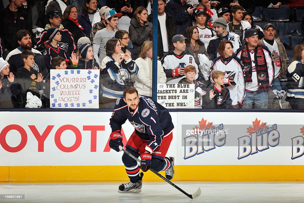Fans show their support for the Columbus Blue Jackets as Nick Foligno #71 of the Columbus Blue Jackets skates by during warm ups before their home opener against the Detroit Red Wings on January 21, 2013 at Nationwide Arena in Columbus, Ohio.