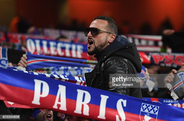 PSG fans show their support for their team prior to kick off during the UEFA Champions League Group A match between Arsenal FC and Paris SaintGermain...
