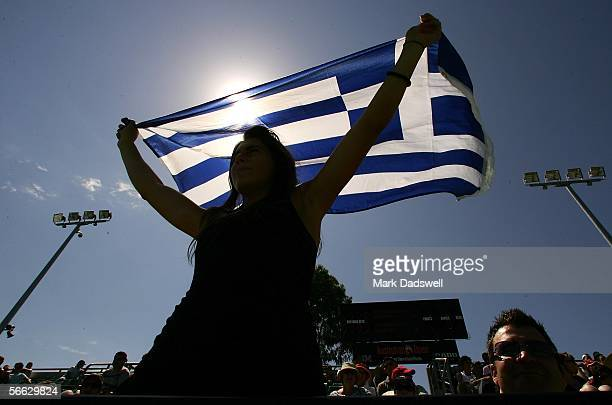 Fans show their support in the third round match between Marcos Baghdatis of Cyprus and Denis Gremelmayr of Germany during day five of the Australian...