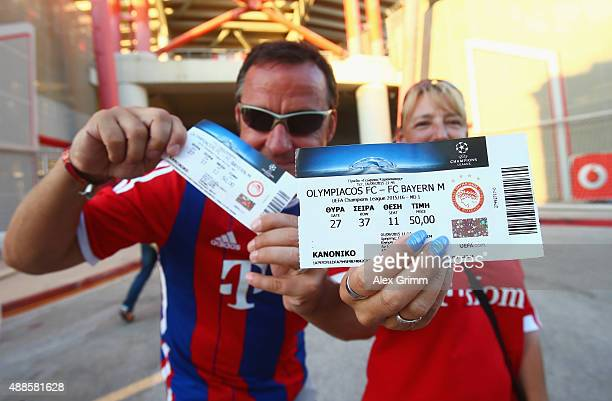 Fans show their tickets outside the stadium prior to the UEFA Champions League Group F match between Olympiacos FC and FC Bayern Munchen at...