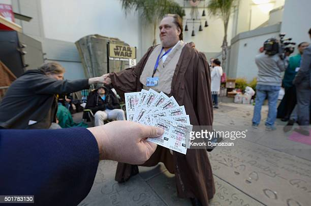 A fans shows their tickets as they wait in line for the opening night of Walt Disney Pictures and Lucasfilm's 'Star Wars The Force Awakens' at TCL...