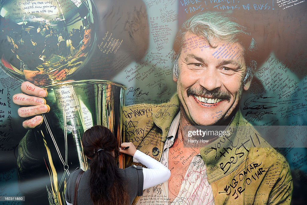 Fans sign the display of Dr. Jerry Buss after his memorail service outside the Nokia Theatre L.A. Live on February 21, 2013 in Los Angeles, California.