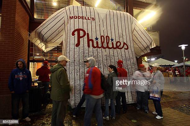 Fans sign their names and messages on a giant replica of a Philadelphia Phillies jersey prior to game three of the 2008 MLB World Series against the...