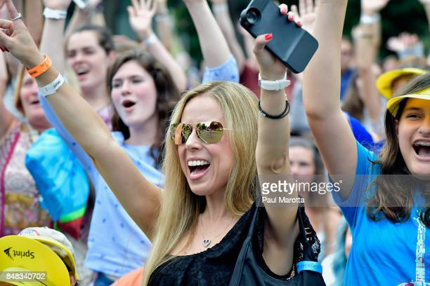 Fans sing along as Andy Grammer performs at Mix 1041 MixFest at Hatch Shell on September 16 2017 in Boston Massachusetts