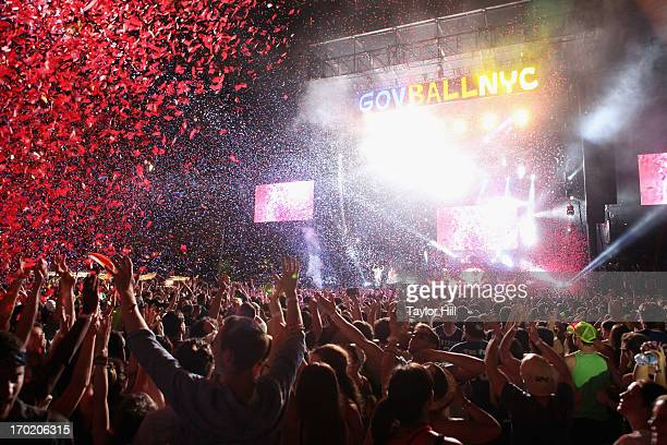 Fans sing along to 'Paradise City' by Guns 'n' Roses during the 2013 Governor's Ball Music Festival at Randall's Island on June 8 2013 in New York...