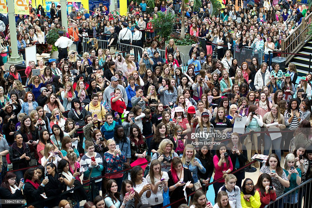 Fans sing along while <a gi-track='captionPersonalityLinkClicked' href=/galleries/search?phrase=Conor+Maynard&family=editorial&specificpeople=8899313 ng-click='$event.stopPropagation()'>Conor Maynard</a> signs autographs and performs at the Mall of America on January 13, 2013 in Bloomington, Minnesota.