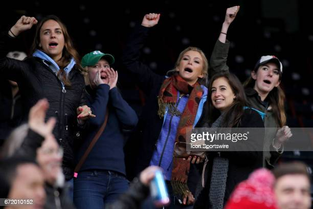 Fans sing along with Sweet Caroline during a game between the North Carolina State Wolfpack and the Boston College Eagles on April 22 at Fenway Park...