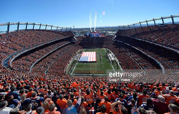 Fans sing the Star Spangled Banner prior to the start of the game The Denver Broncos vs The New England Patriots in an AFC Championship game at...