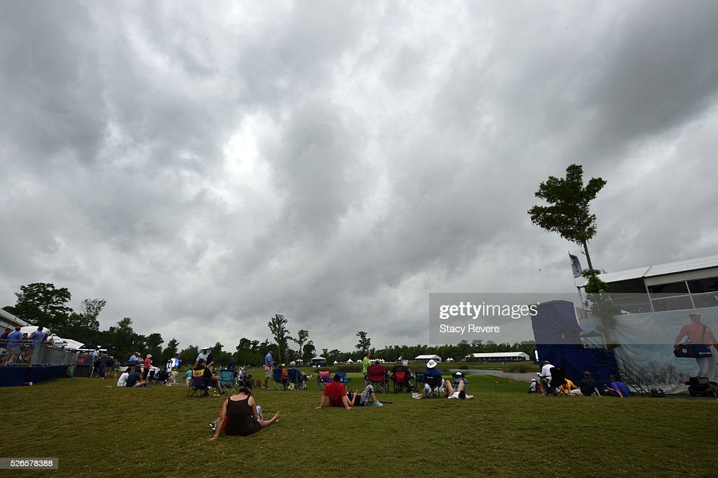 Fans sit along the ninth hole as weather approaches during the third round of the Zurich Classic at TPC Louisiana on April 30, 2016 in Avondale, Louisiana.