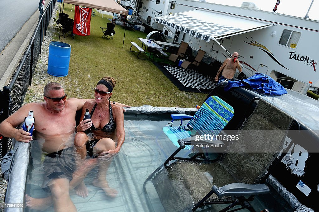 Fans sit in a makeshift pool in the infield during practice for the NASCAR Sprint Cup Series AdvoCare 500 at Atlanta Motor Speedway on August 31, 2013 in Hampton, Georgia.