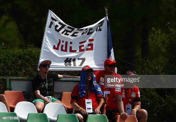 Fans sit in front of a banner displaying a message in memory of Jules Bianchi during practice for the Formula One Grand Prix of Hungary at...