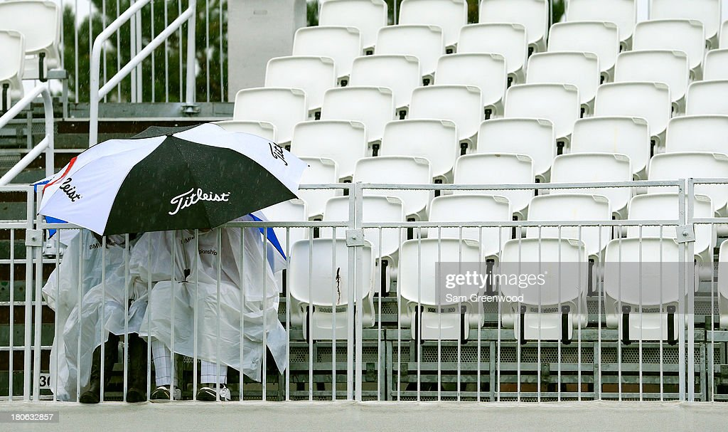 Fans sit in the grandstand while play is suspended due to inclement weather during the Final Round of the BMW Championship at Conway Farms Golf Club on September 15, 2013 in Lake Forest, Illinois.