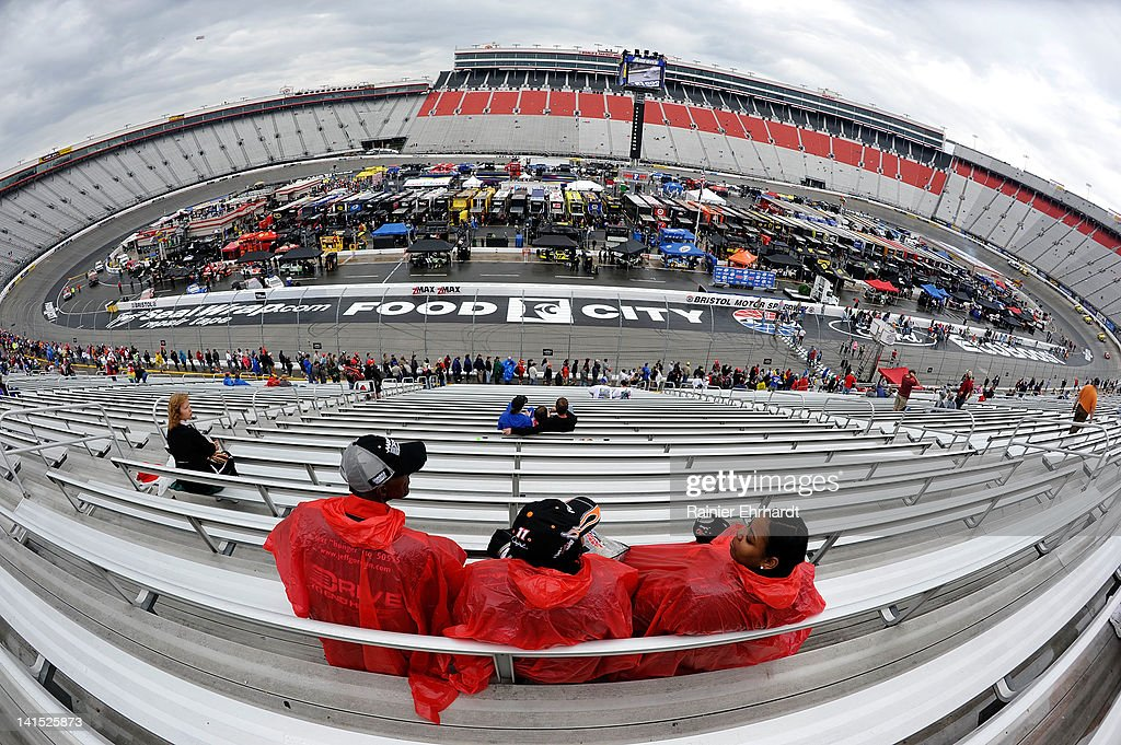 Fans sit in the rain in the grandstands prior to the NASCAR Sprint Cup Series Food City 500 at Bristol Motor Speedway on March 18, 2012 in Bristol, Tennessee.