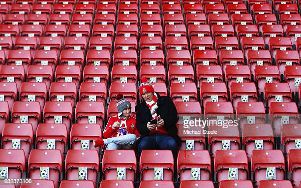 Fans sit in the stands prior to the Premier League match between Southampton and Leicester City at St Mary's Stadium on January 22 2017 in...