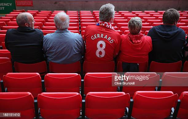 Fans sit in their seats early at the stadium prior to the Barclays Premier League match between Liverpool and Crystal Palace at Anfield on October 5...
