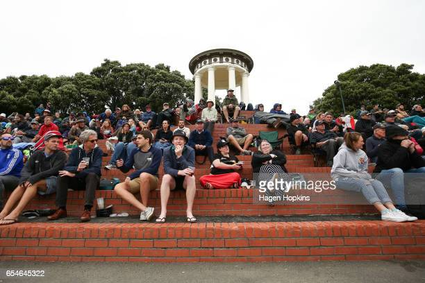 Fans sit on the steps in front of the Wakefield Memorial during day three of the test match between New Zealand and South Africa at Basin Reserve on...