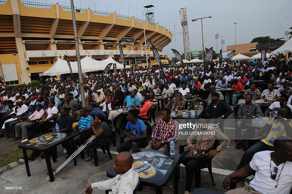 Fans sit to watch Nigeria's match with Ethiopia at a public viewing centre in Lagos January 29, 2013. Nigeria defeated Ethiopia 2-0 in Group C match played at Royal Bafokeng Stadium, Rustenburg to qualify for quater-finals of the 2013 Africa Cup of Nations in South Africa