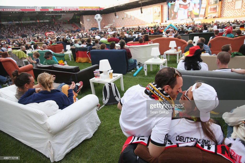 Fans sitting on sofas watch the Germany-Portugal World Cup match at a public viewing at the Alte Foersterei FC Union stadium on June 16, 2014 in Berlin, Germany. The stadium has allowed fans to bring 700 sofas that they've set up on the lawn to watch the World Cup matches on a giant monitor.