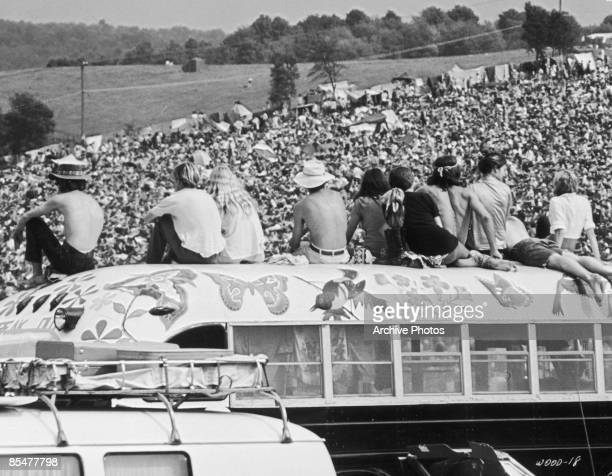 Fans sitting on top of a painted bus at the Woodstock Music Festival Bethel New York 15th17th August 1969