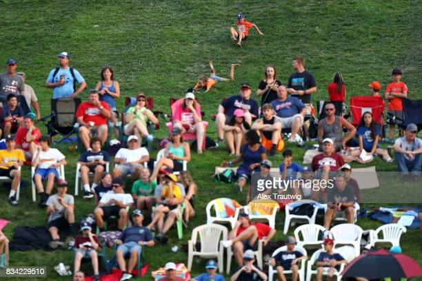 Fans slide down the hill during Game 4 of the 2017 Little League World Series between the Great Lakes team from Michigan and the Southwest team from...