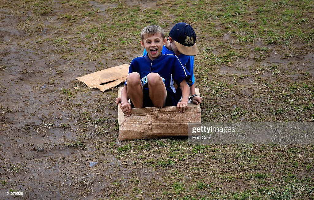 Fans slide down the hill in the outfield during the International Championship game of the Little League World Series at Lamade Stadium on August 23, 2014 in South Williamsport, Pennsylvania.