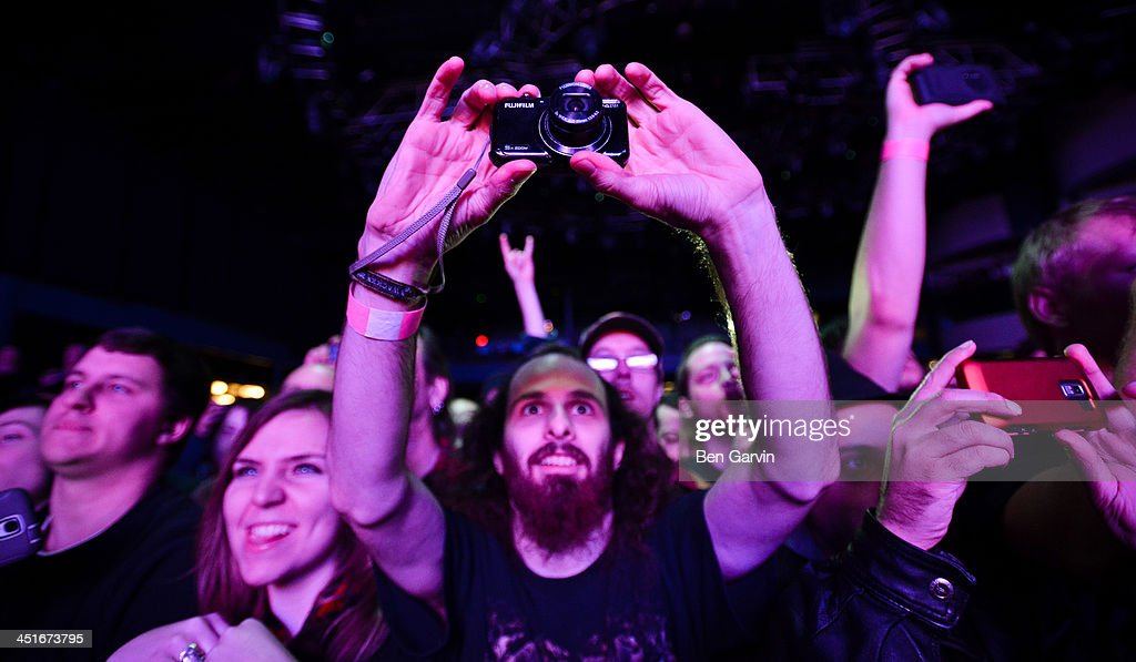 Fans snap photos as Megadeth perform at the Myth Nightclub on November 23, 2013 in St. Paul, Minnesota. It was their first stop as part of their new Super Collider Tour.