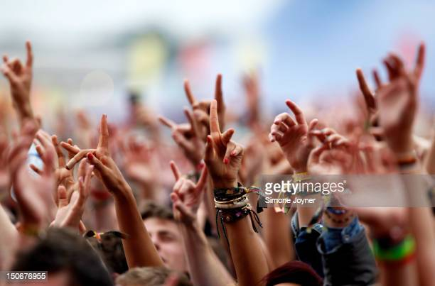 Fans soak up the atmopshere as Coheed and Cambria perform live on the Main Stage during Day One of Reading Festival 2012 at Richfield Avenue on...