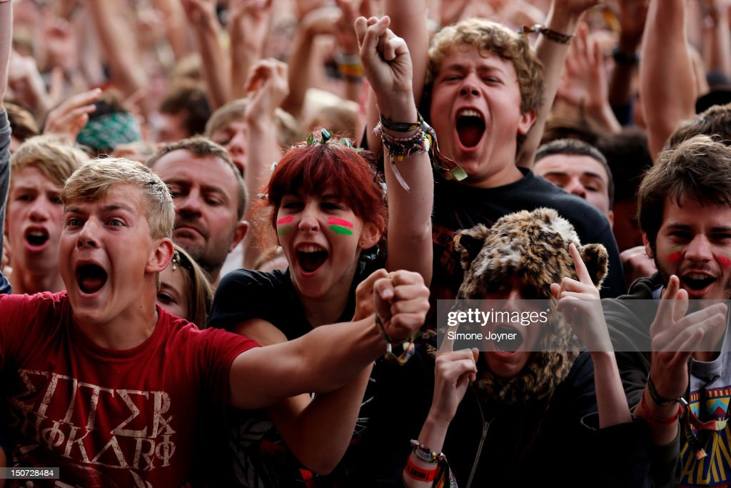 Fans soak up the atmopshere as Enter Shikari perform live on the Main Stage on Day Two during the Reading Festival 2012 at Richfield Avenue on August 25, 2012 in Reading, England.