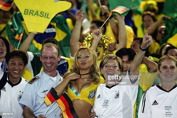 Fans soak up the atmosphere during the Germany v Brazil World Cup Final match played at the International Stadium Yokohama in Yokohama Japan on June...