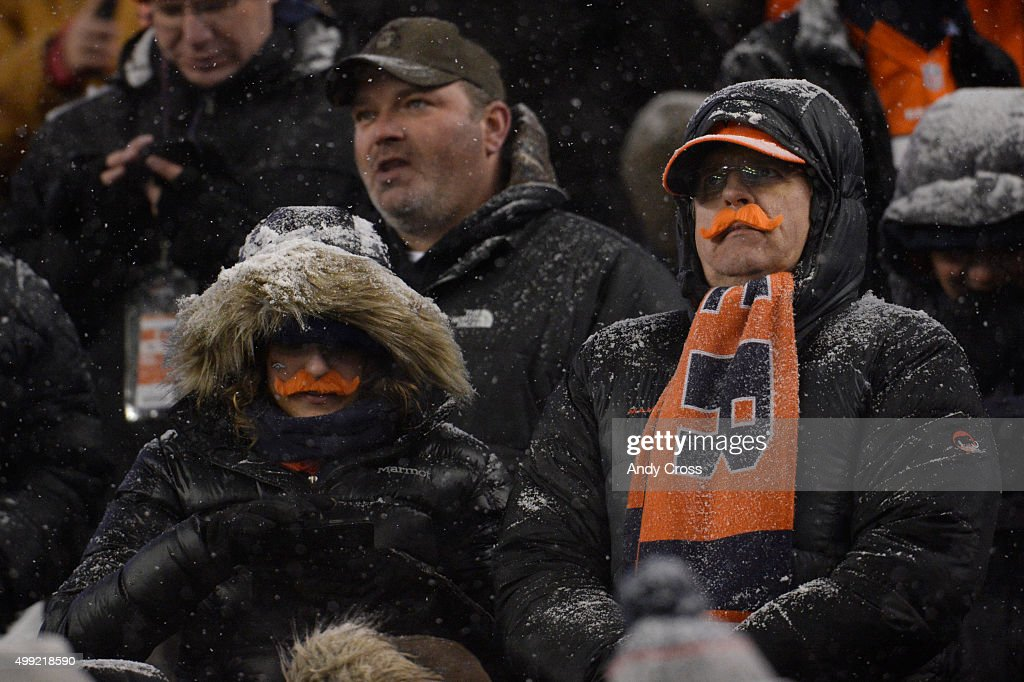 Fans sport orange mustaches in an attempt to break a world record. The Broncos played the New England Patriots at Sports Authority Field at Mile High in Denver, CO on November 29, 2015.