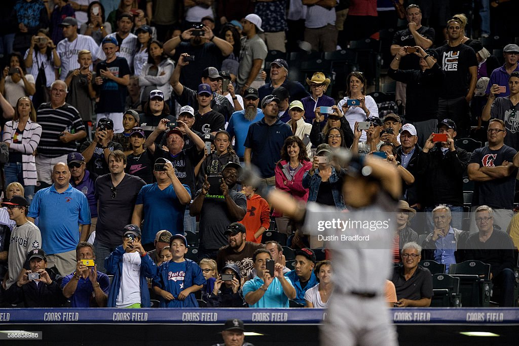 Fans stand and watch as Ichiro Suzuki #51 of the Miami Marlins takes an at bat in the ninth inning trying to record his 3,000th major league hit at Coors Field on August 6, 2016 in Denver, Colorado. Suzuki grounded out to the pitcher Scott Oberg #45 of the Colorado Rockies on the play.