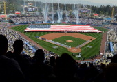 Fans stand for the National Anthem before the game between the San Francisco Giants and the Los Angeles Dodgers on opening day at Dodger Stadium on...