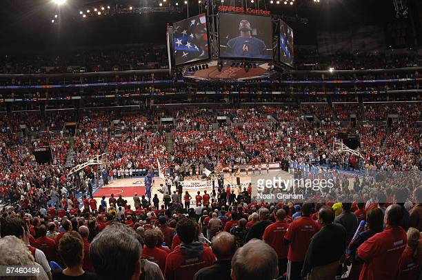 Fans stand for the National Anthem before the Los Angeles Clippers game against the Denver Nuggets in game one of the Western Conference...