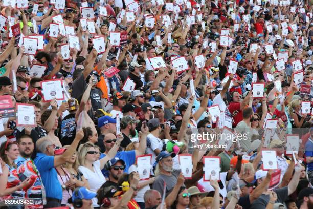 Fans stand for the national anthem during the Monster Energy NASCAR Cup Series CocaCola 600 at Charlotte Motor Speedway on May 28 2017 in Charlotte...